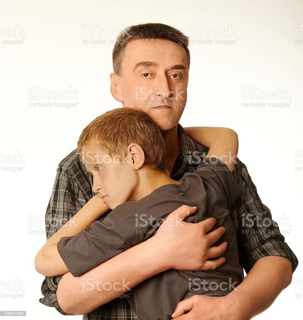 The ten years' son and father embrace each other stock photo
