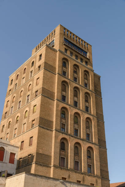 The terracotta tower; Brescia Italy. Fascist style victory square stock photo