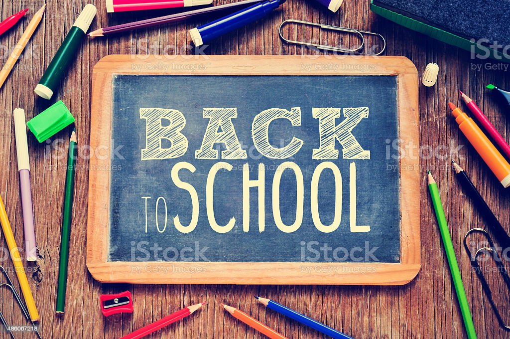 the text back to school written on a chalkboard stock photo