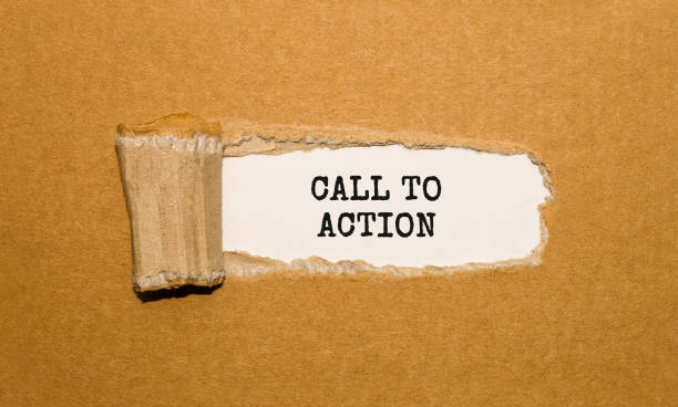 The text Call To Action appearing behind torn brown paper stock photo