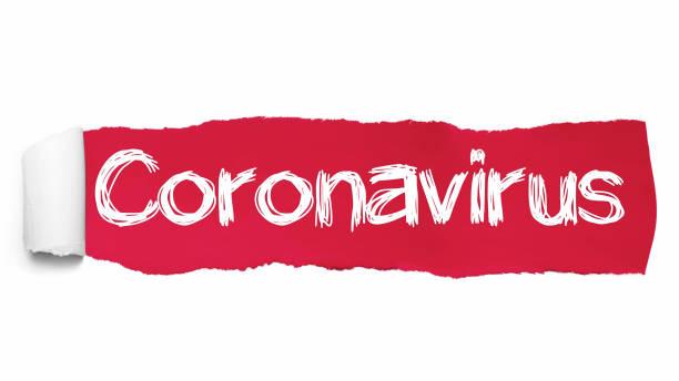 de tekst coronavirus geschreven onder het gekrulde stuk rood gescheurd papier - tears corona stockfoto's en -beelden