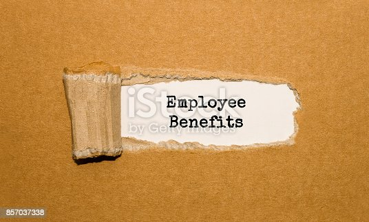 1018458132istockphoto The text Employee Benefits appearing behind torn brown paper 857037338