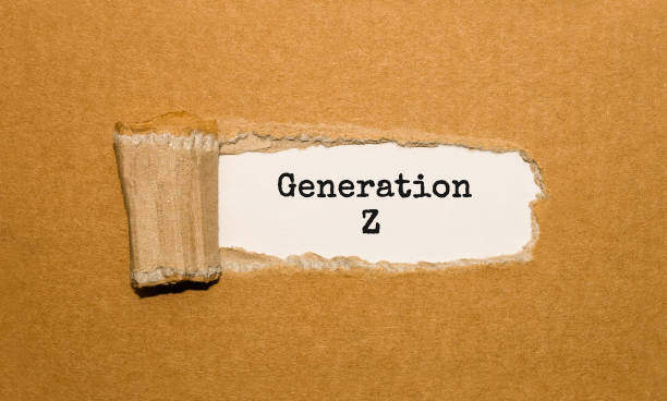 The text Generation Z appearing behind torn brown paper The text Generation Z appearing behind torn brown paper generation z stock pictures, royalty-free photos & images