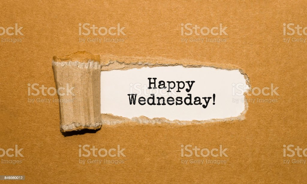 The text Happy Wednesday appearing behind torn brown paper stock photo