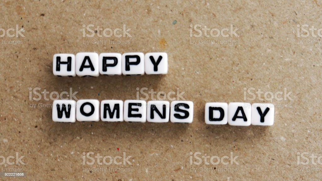 The text HAPPY WOMENS DAY with white cube. stock photo