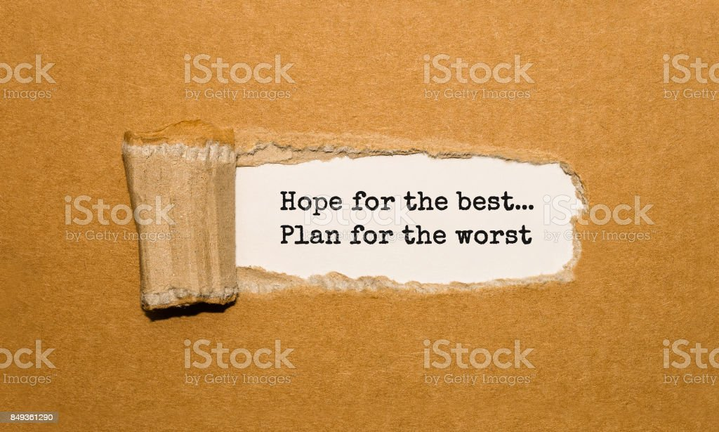 The text Hope for the best Plan for the worst appearing behind torn brown paper stock photo