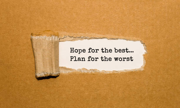 the text hope for the best plan for the worst appearing behind torn brown paper - plan for worst stock pictures, royalty-free photos & images