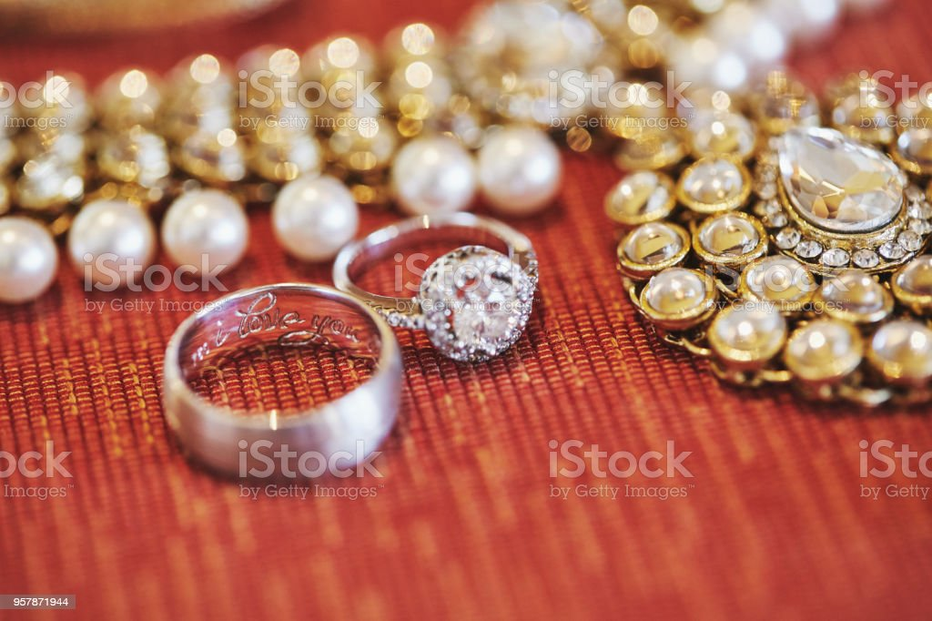 The Text I Love You Embedded Inside The Engagement Ring Of The Groom With The Diamond Ring And Necklace Of The Bride Beside Stock Photo Download Image Now Istock