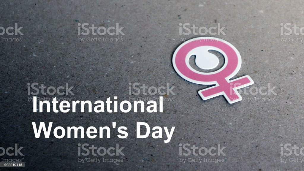 The text International Women's Day and women symbol. stock photo