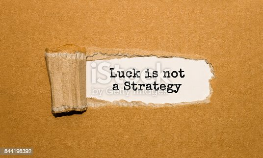 istock The text Luck is not A Strategy appearing behind torn brown paper 844198392