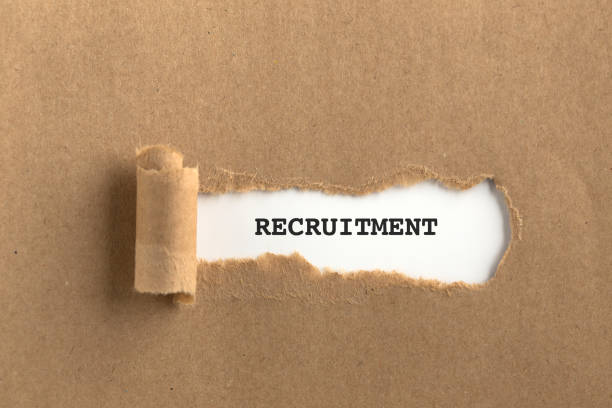 The text RECRUITMENT behind torn brown paper The text RECRUITMENT behind torn brown paper military recruit stock pictures, royalty-free photos & images