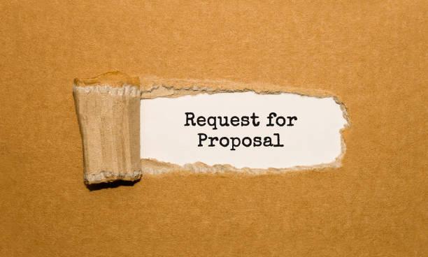 der text request for proposal erscheint hinter zerrissenes papier braun - verlobung stock-fotos und bilder