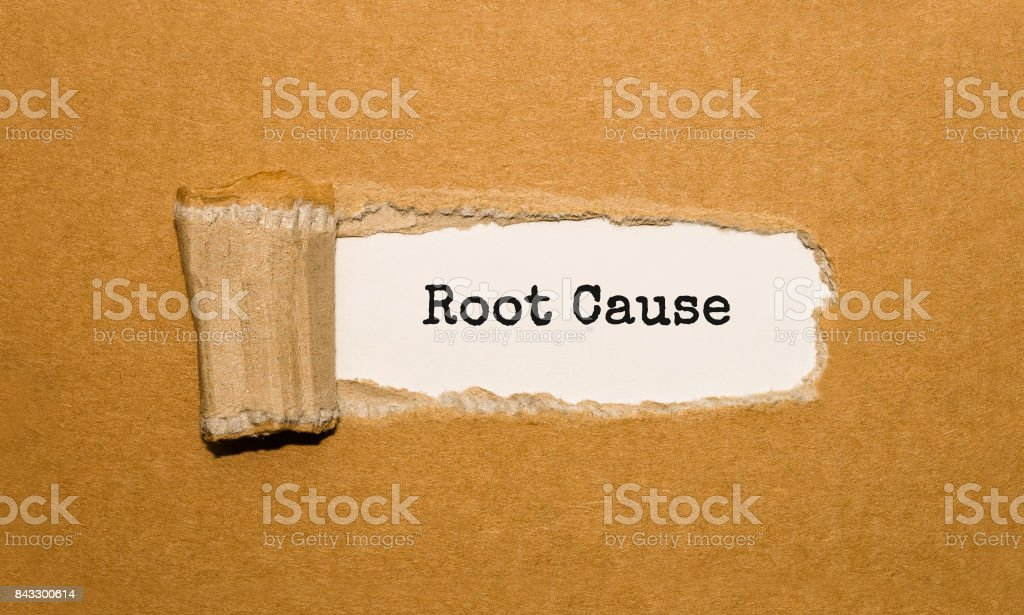 The text Root Cause appearing behind torn brown paper