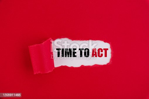 istock The text Time to act appearing behind torn red paper. 1205911465