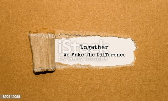 istock The text Together We Make The Difference appearing behind torn brown paper 850142088