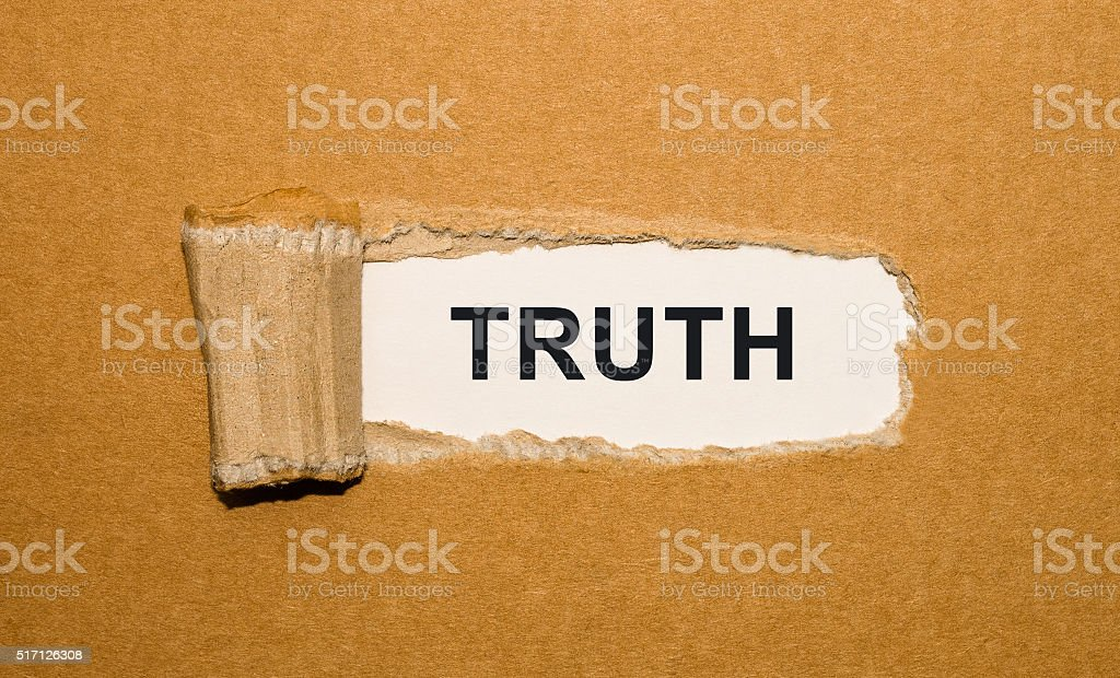 The text Truth appearing behind torn brown paper stock photo