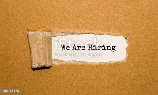 istock The text We Are Hiring appearing behind torn brown paper 850145170