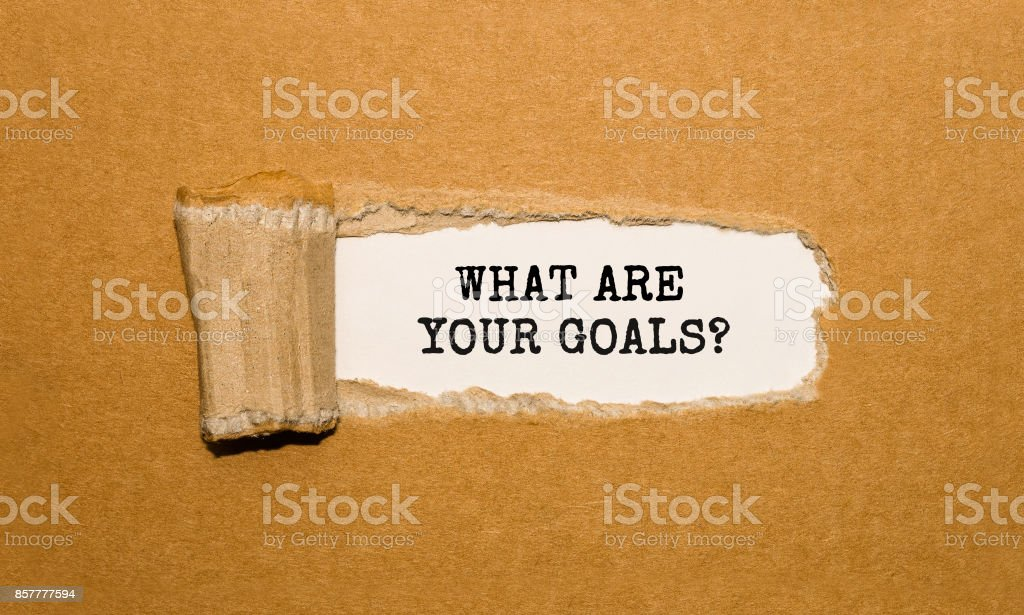 The text WHAT ARE YOUR GOALS appearing behind torn brown paper stock photo