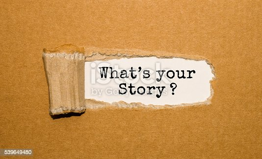 istock The text What's your story? appearing behind torn brown paper 539649480