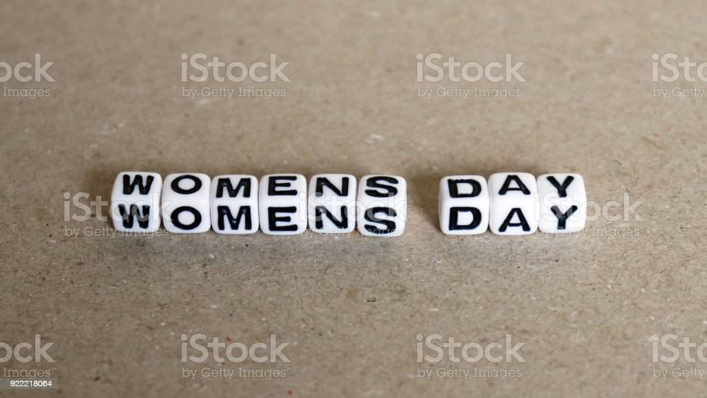 The text WOMENS DAY with white cube. stock photo