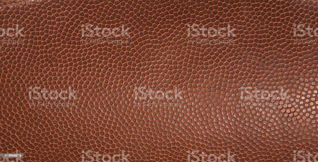 The texture from an American football  stock photo