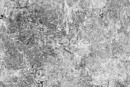 The texture is black and white in grunge style. Abstract monochrome background. Pattern of chips, cracks, scuffs, dust, stains