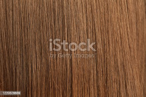 The texture of beautiful women's brown hair after the Barber's procedure