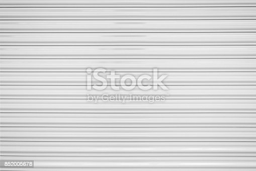 The texture of corrugated metal sheet, white or gray galvanizes steel rolling shutter.