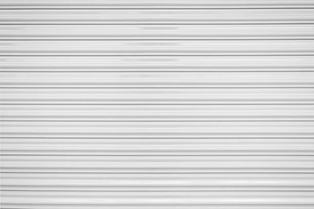 die textur der gewellten blech, weiß oder grau bringt stahl rolling-shutter. - garagentor mit tür stock-fotos und bilder