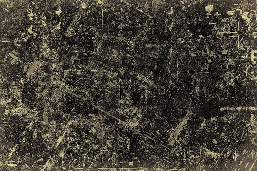 The texture of old burnt paper. Vintage dark background of faded surface
