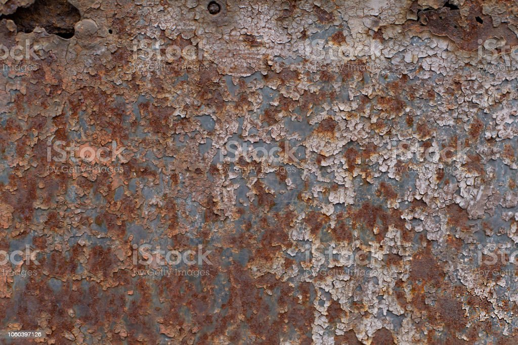 The texture of old rusty cracked painted metal surface stock photo