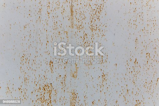 istock The texture of painted metal gates covered with shallow rust 946988528