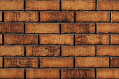 The texture of the brick wall is yellow brown red, the background is made of brickwork from a new modern building material