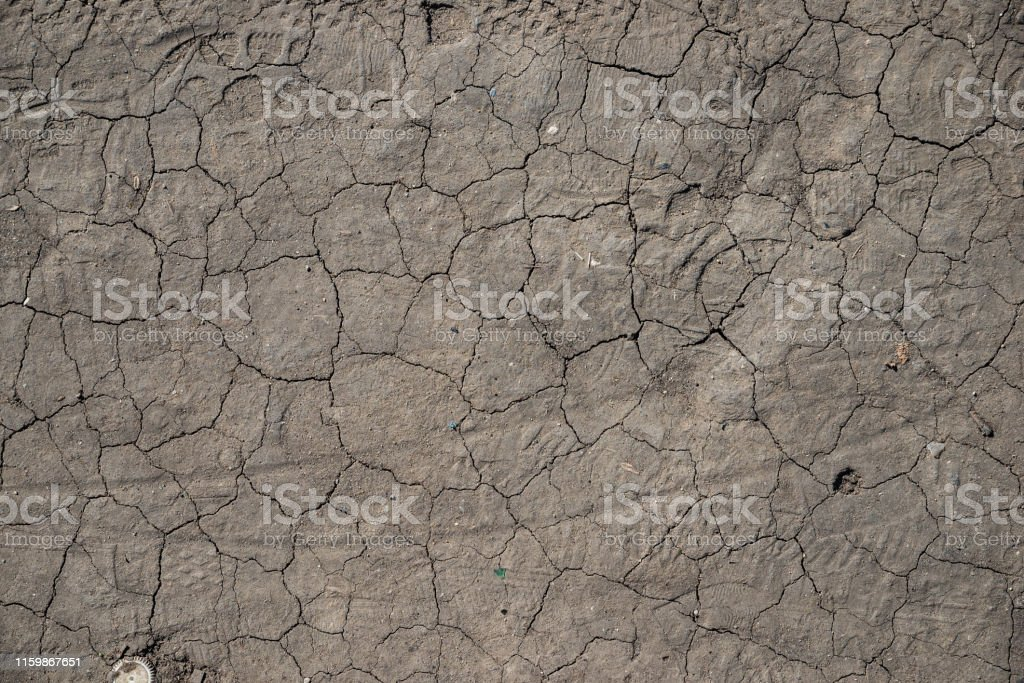 The texture of the cracks on the dry land during a drought
