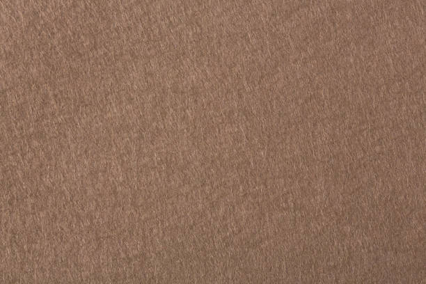 The texture of the dark brown felt. The background of dark brown cloth. The texture of the dark brown felt. The background of dark brown cloth. High resolution photo. felt textile stock pictures, royalty-free photos & images