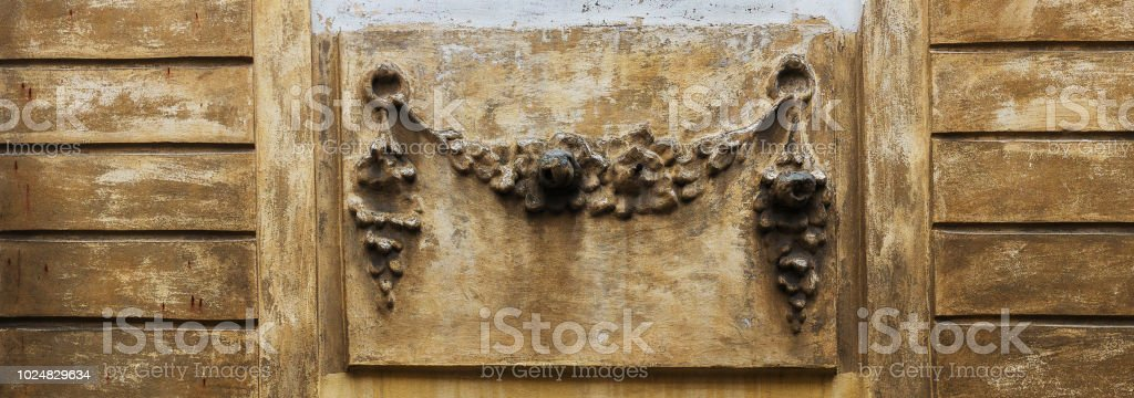 The Texture Of The Old Molding On The Facade Of The House