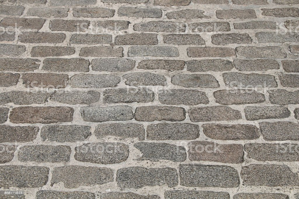 The texture of the pavement paved with cobbled stone stock photo