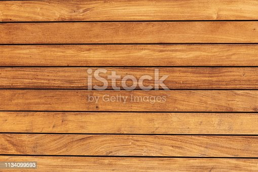 The texture of the pine boards. Horizontal wooden fence.
