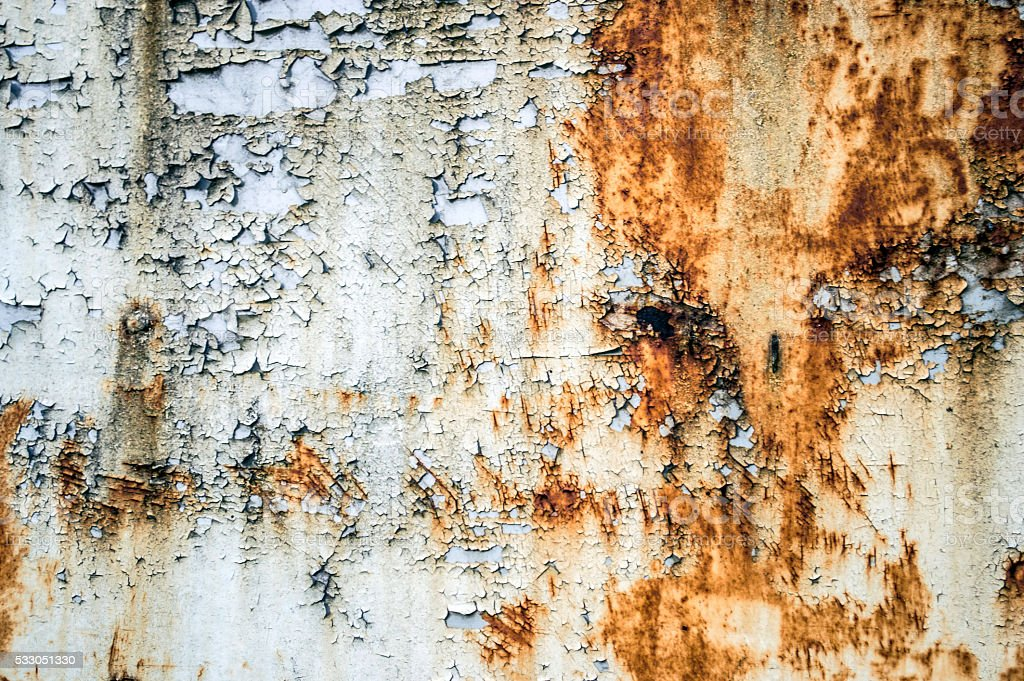 The texture of the rusting metal on a white metal stock photo