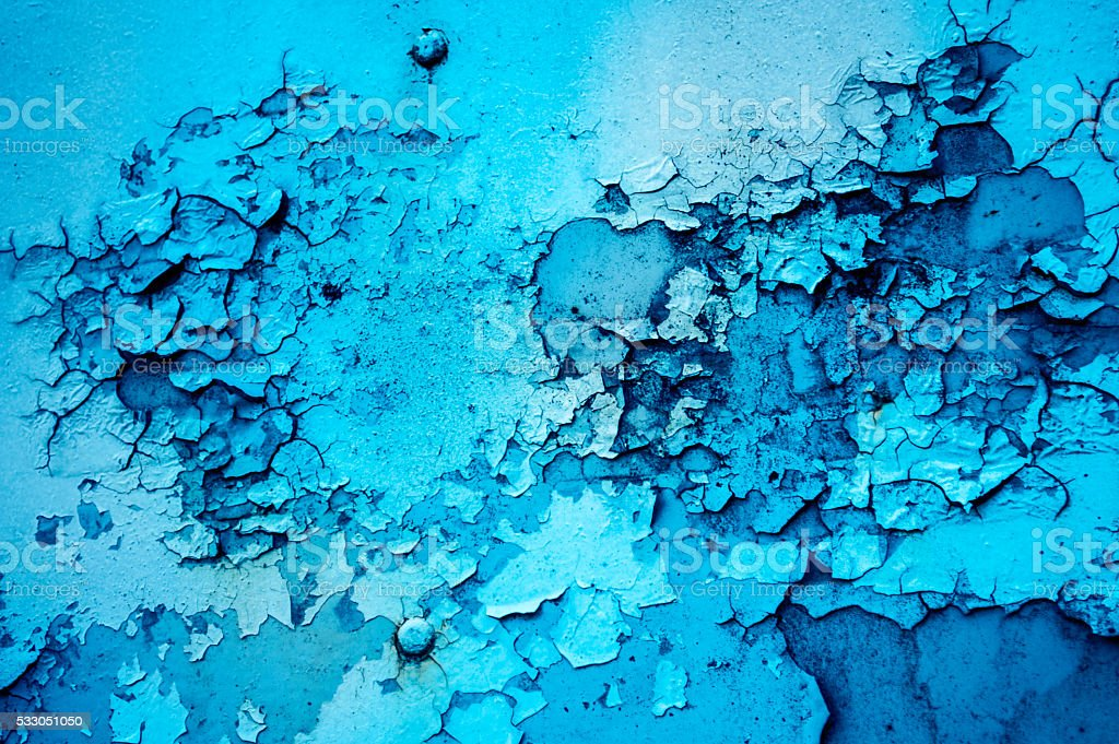 The texture of the rusting metal on blue metal stock photo