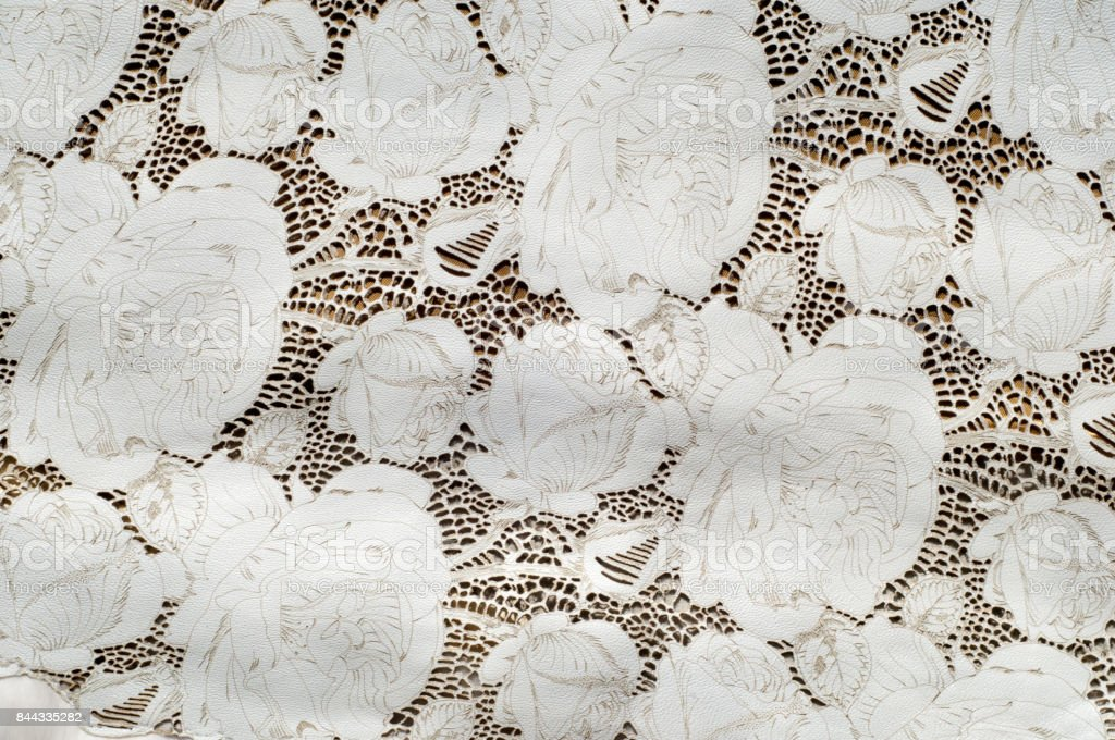 the texture of the skin with embossed floral pattern stock photo