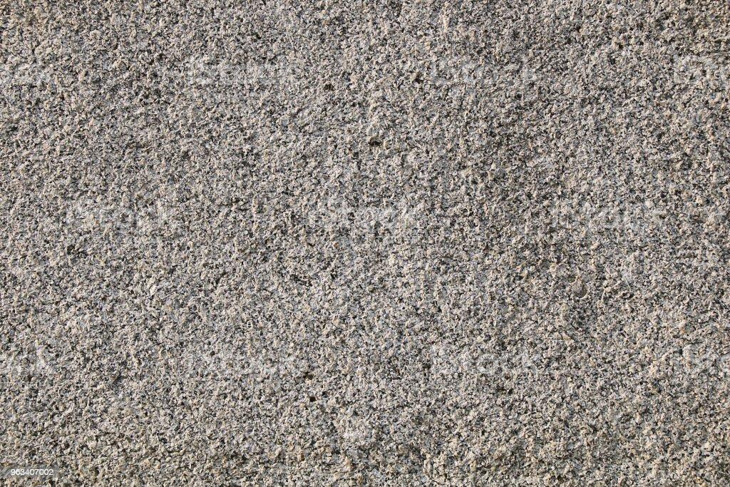The texture of the stones and cobblestones. Fragment of a gray granite wall. - Zbiór zdjęć royalty-free (Bez ludzi)