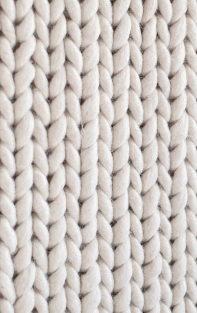 The texture of the woolen carpet pigtails. Handmade carpet fabric texture for background. stock photo