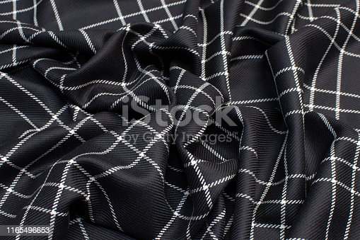 The texture of the woolen fabric in the cell is black and white. Background, pattern.