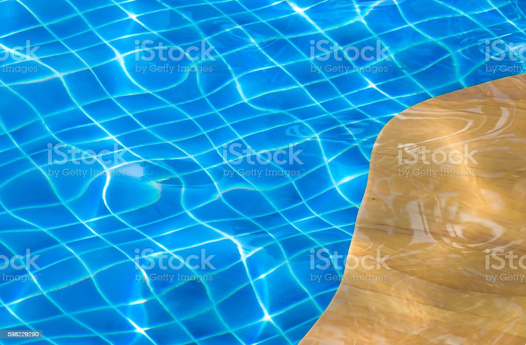 the texture of water in swimmingpool with yellow edge pool foto royalty-free