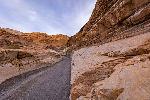 The textured striations of marble. Smooth, polished marble walls enclose the trail as it follows the canyon's sinuous curves. Mosaic Canyon, Death Valley National Park, California