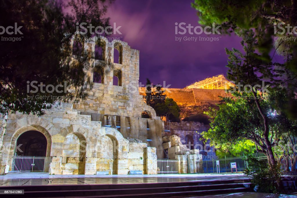 The theater of Herodion Atticus under the ruins of Acropolis at night, Athens, Greece. stock photo