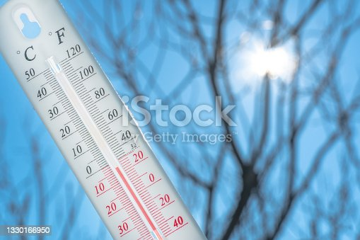 istock The thermometer lies on the snow and shows a negative temperature in cold weather on the blue sky.Meteorological conditions with low air and ambient temperatures.Climate change and global warming 1330166950