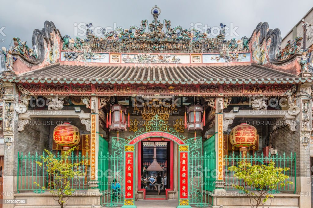 The Thien Hau Temple In Chalon, Ho Chi Minh City, Vietnam Ho Chi Minh, Vietnam - November, 22 2015 - A view of the Ba Thien Hau Pagoda in the Cholon area of Ho Chi Minh City in Vietnam.  Front view.  Incense burning in the centre of the temple Architecture Stock Photo