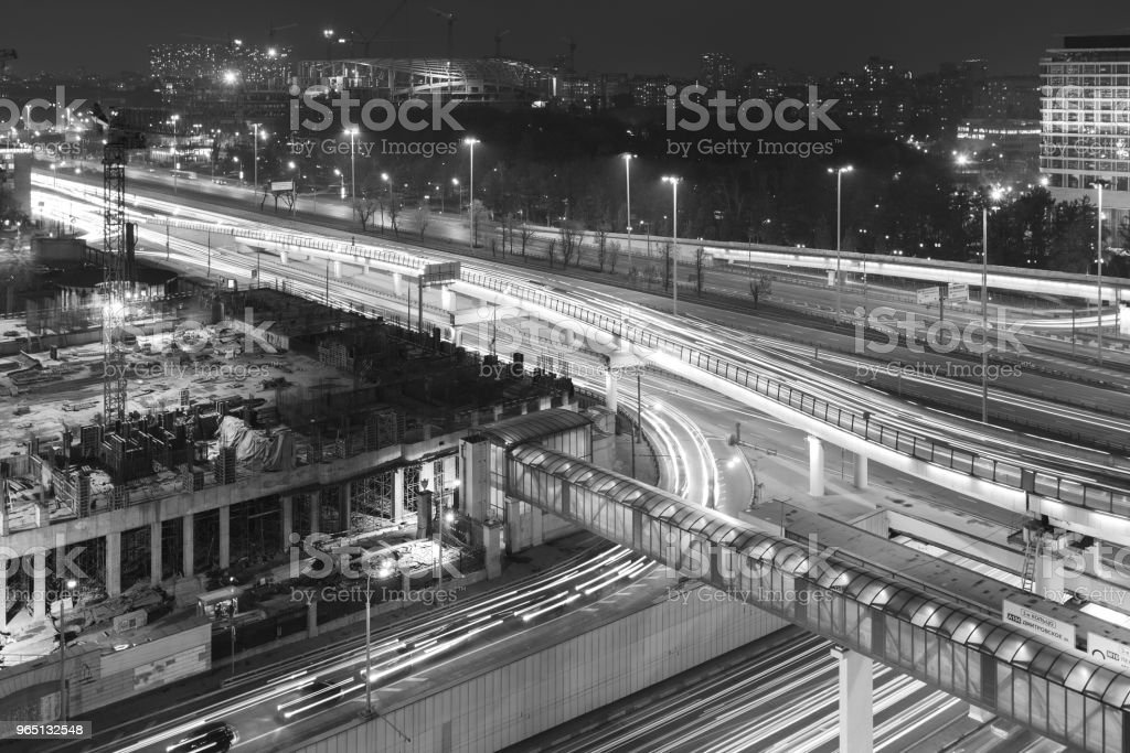 The third ring road in the night in black and white. Light from the headlights of passing cars zbiór zdjęć royalty-free